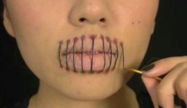 womans-mouth-sewed-up